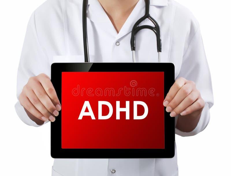Docteur montrant le comprimé avec le texte d'ADHD image stock