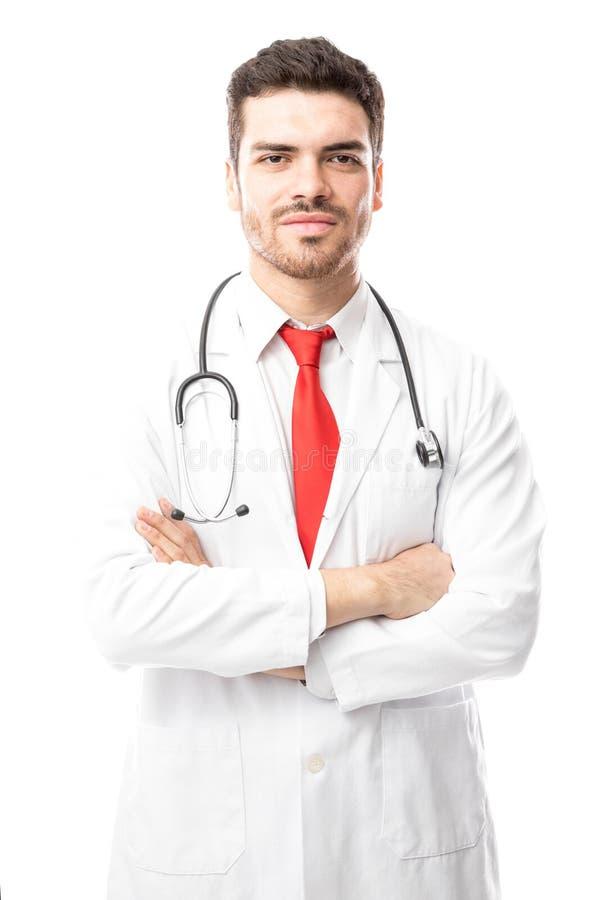 Docteur sûr avec des bras croisés photo libre de droits