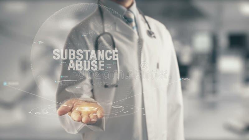 Docteur tenant la toxicomanie disponible photo stock