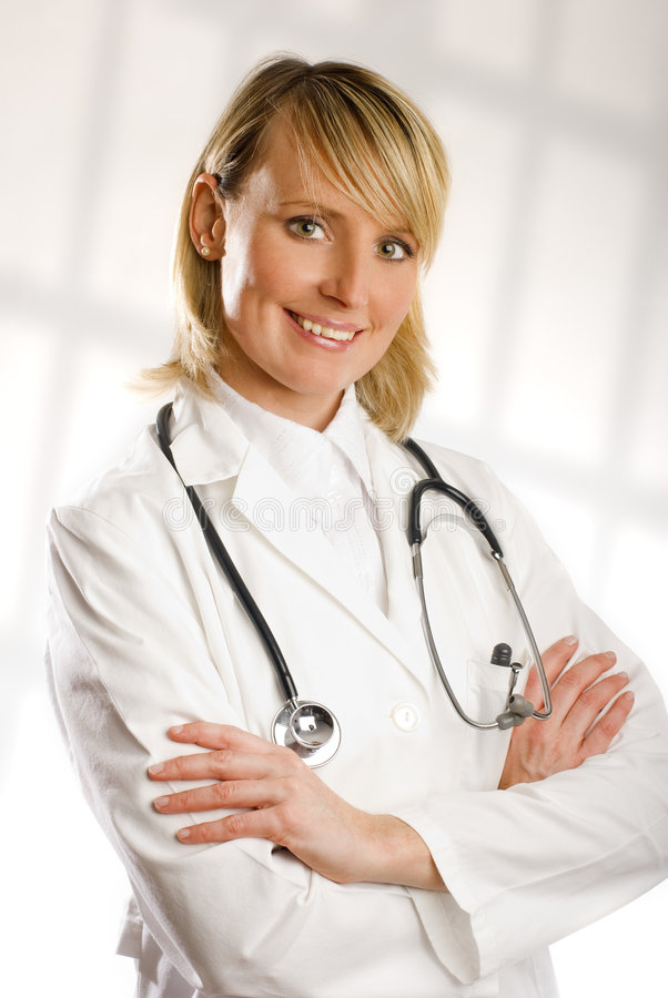 Doctor. Young blond female doctor portrait close up shoot stock photography