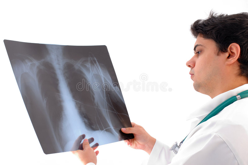 Doctor. The Doctor with stethoscope Analyzing X-Ray stock photo