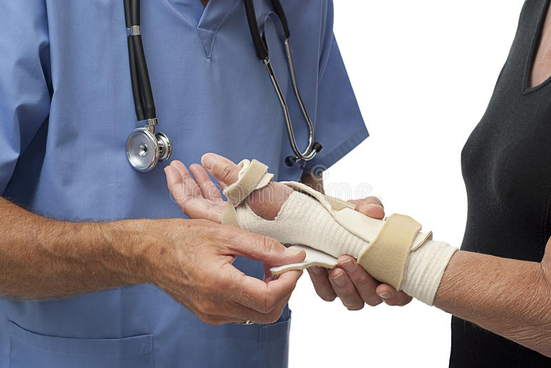 Download Doctor Adjusting Patient's Wrist Brace Stock Photo - Image: 10837936