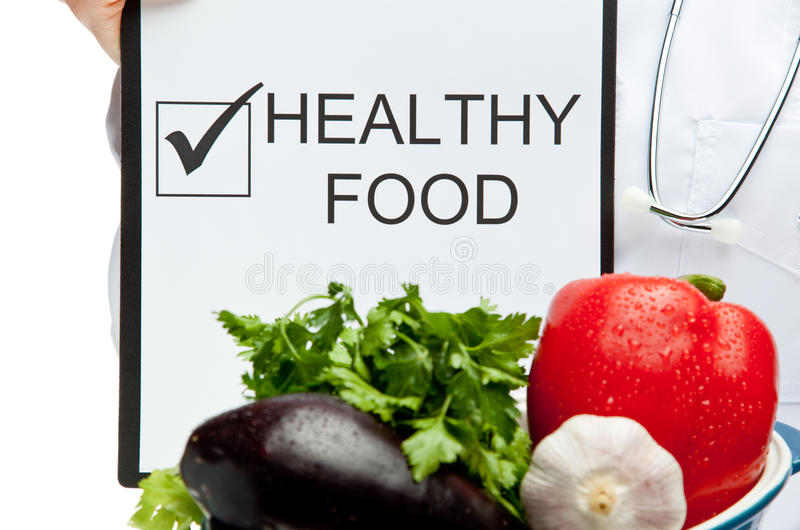 Doctor advising healthy food royalty free stock photo