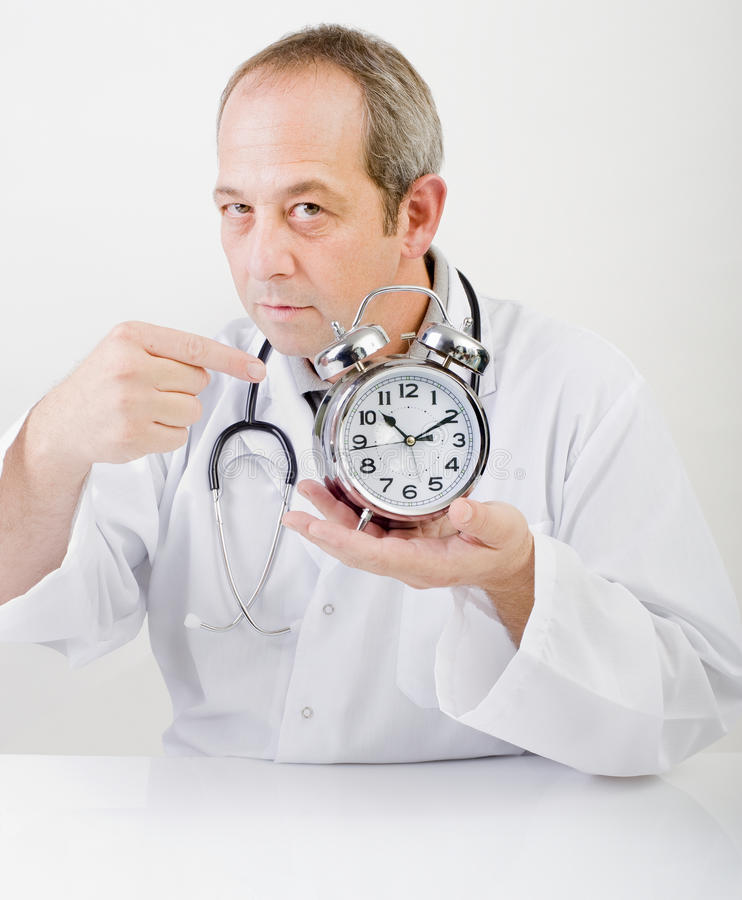 Download Doctor alarmclock stock image. Image of male, hospital - 11018685