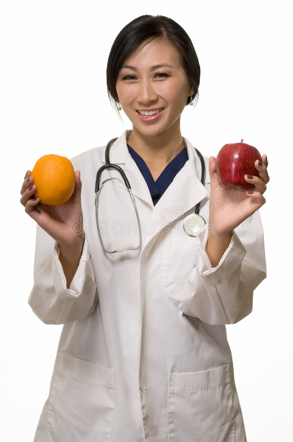 Download Doctor With Apple And Orange Stock Image - Image of female, concept: 6875941