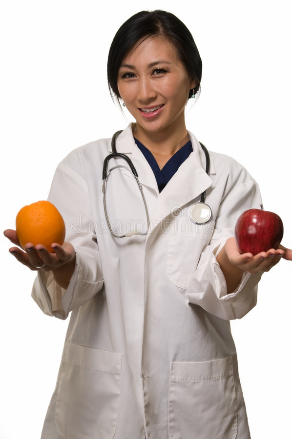 Download Doctor With Apple And Orange Stock Photo - Image: 6913804