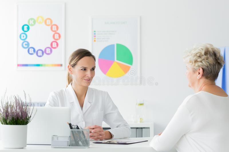 Doctor happy with patient`s progress stock images