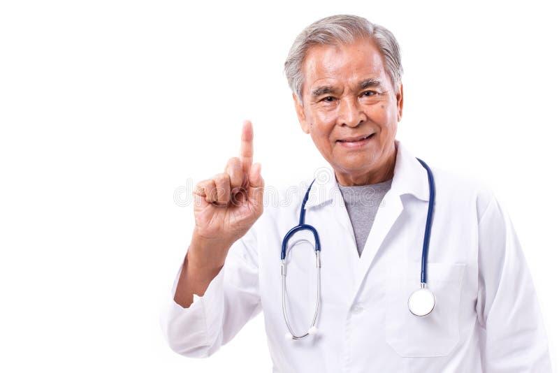 Doctor asiático que da la sugerencia, mostrando 1 gesto del finger fotografía de archivo