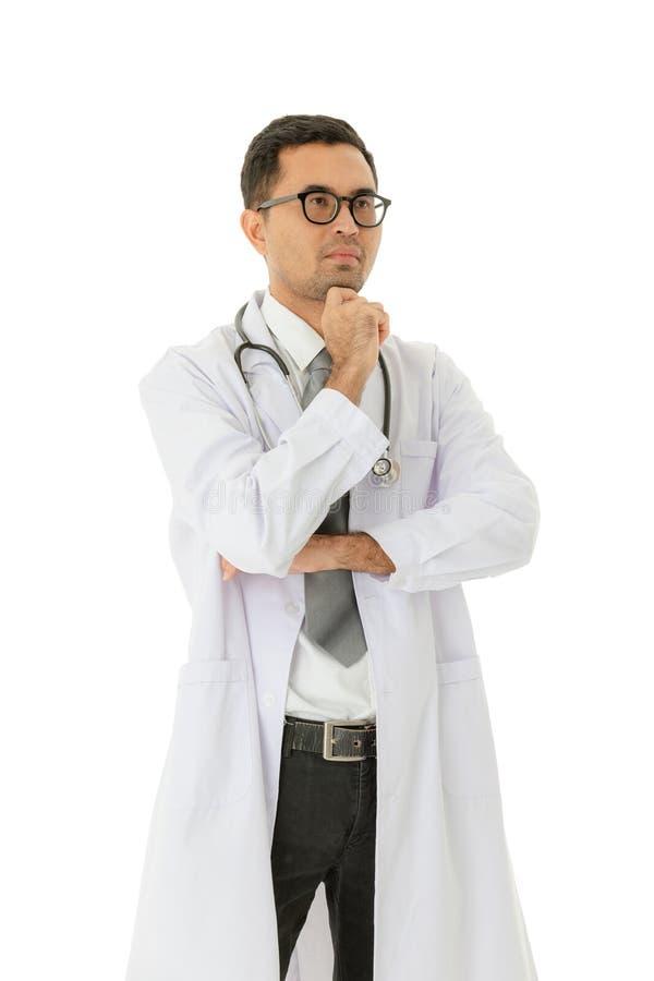 Doctor asi?tico en el trabajo imagen de archivo libre de regalías
