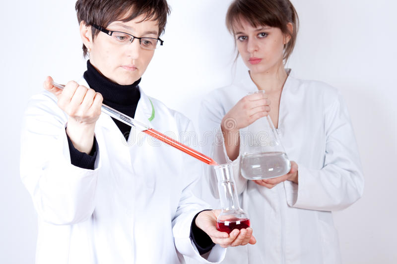 Download Doctor With Assistant - Experimenting Stock Image - Image: 13257239