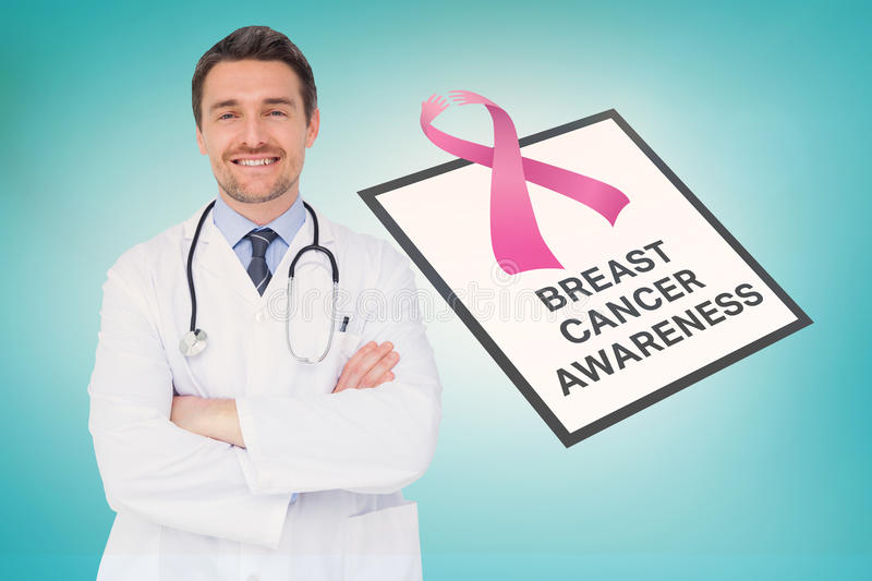 Doctor with breast cancer awareness message. For awareness month royalty free stock photography