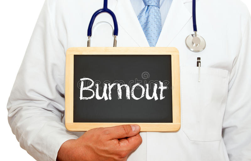 Doctor with burnout sign. Body of doctor with stethoscope holding chalkboard or blackboard with word burnout stock photography