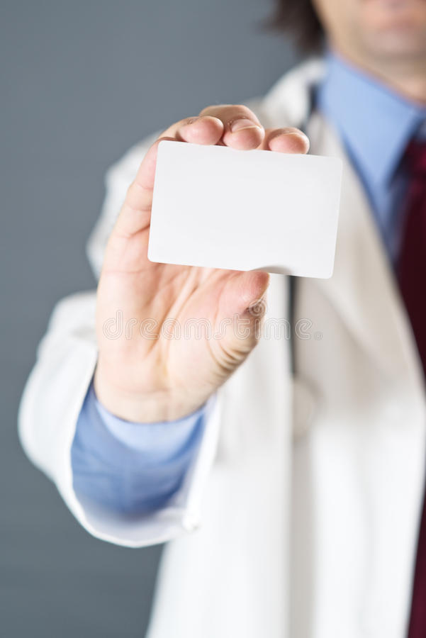Doctor With Business Card Royalty Free Stock Images