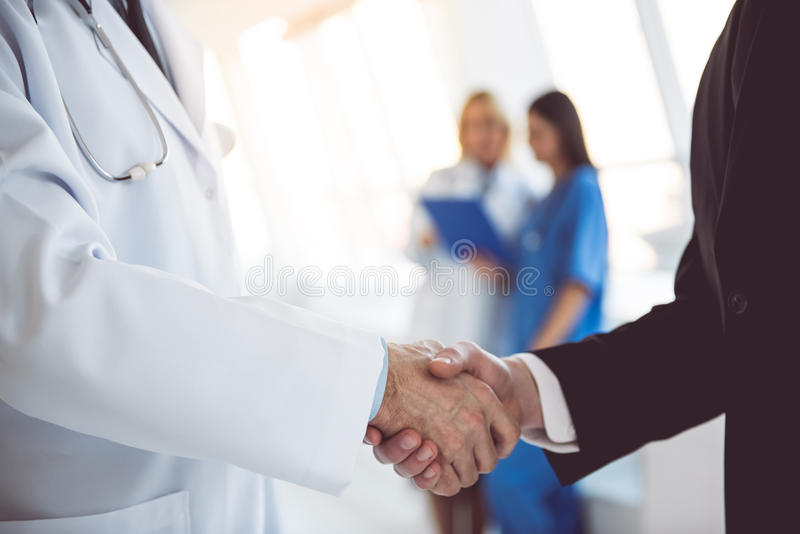 Doctor and businessman royalty free stock images