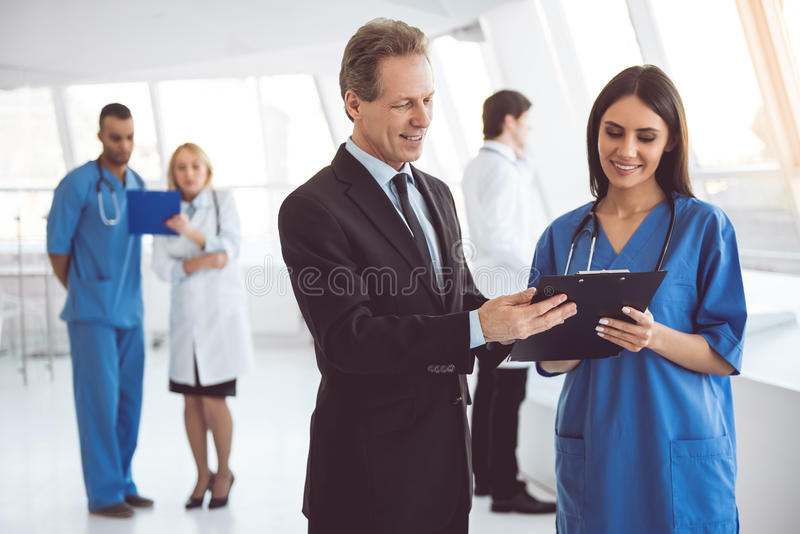 Doctor and businessman royalty free stock photography