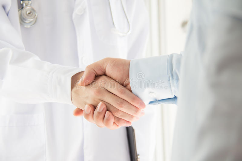 Doctor and businessman. Shaking hands royalty free stock images