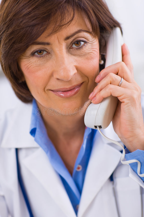 Doctor calling on phone stock image