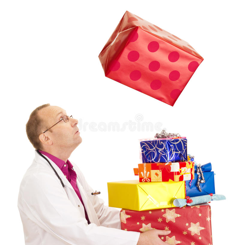 Doctor catching a very big gift. A doctor catching a very big gift royalty free stock photo