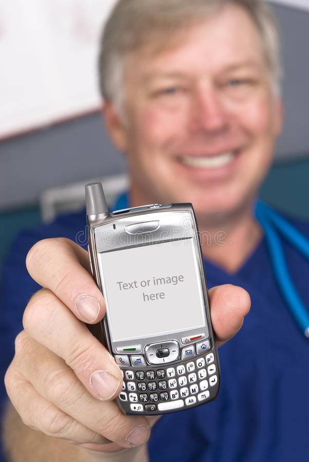 Doctor and cell phone. A doctor displays his cell phone as if showing someone the screen display. The screen comes with a clipping path. I have made the copy royalty free stock photos