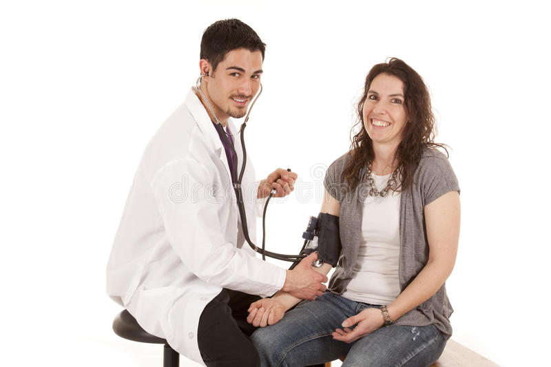 Download Doctor Check Blood Pressure Smile Stock Image - Image: 19565969