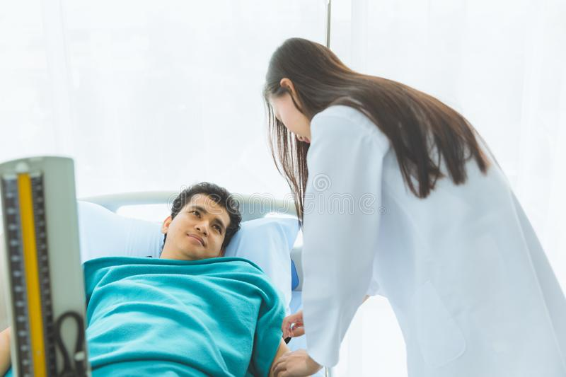 Doctor check patient`s blood pressure in hospital..Doctor check patient`s blood pressure in hospital stock images