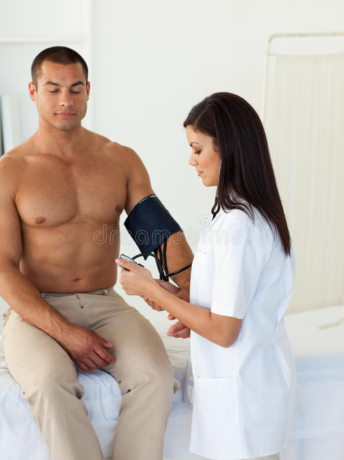 Doctor Checking The Blood Pressure Of A Patient Royalty Free Stock Photography