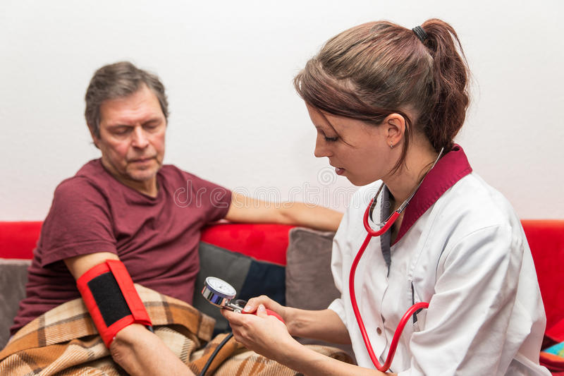 Doctor is checking blood pressure royalty free stock photo
