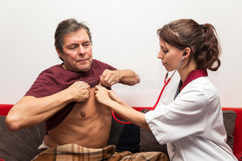 Doctor is checking heartbeat. Doctor and patient checking heartbeat stock photography