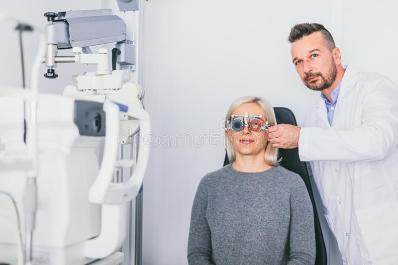 Doctor checking his patients eyesight stock images