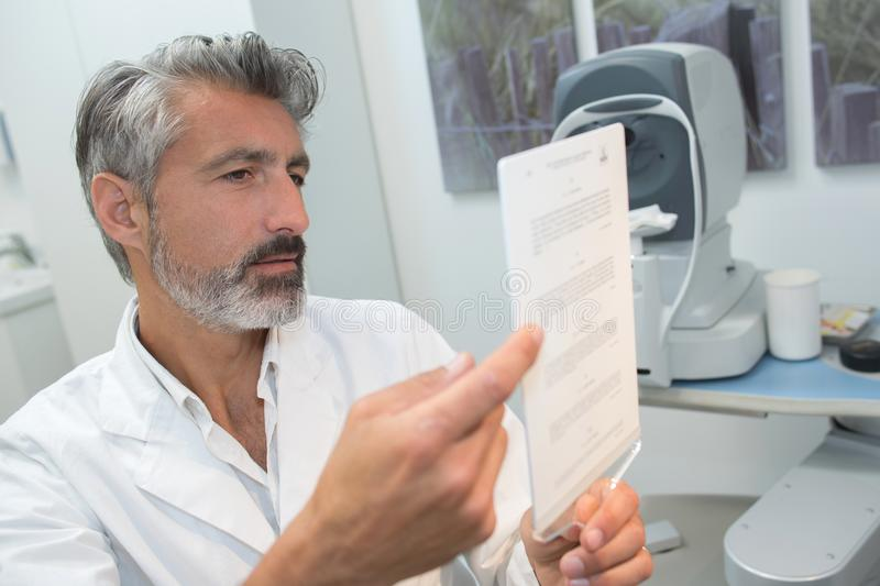 Doctor checking medical tests results stock photo