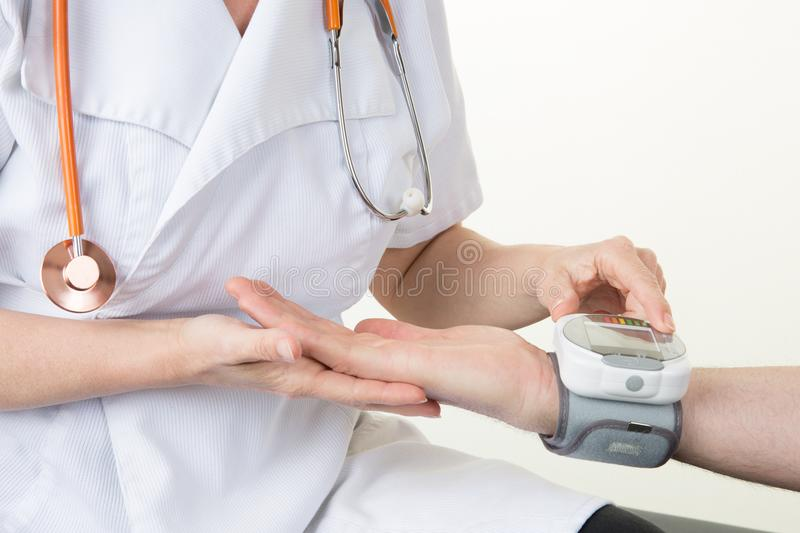 Doctor checking patient arterial blood pressure in hospital in  digital monitor Health care Concept stock images