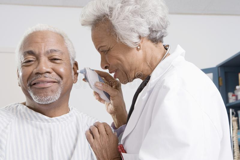 Doctor Checking Patient s Ear Using Electronic Otoscope