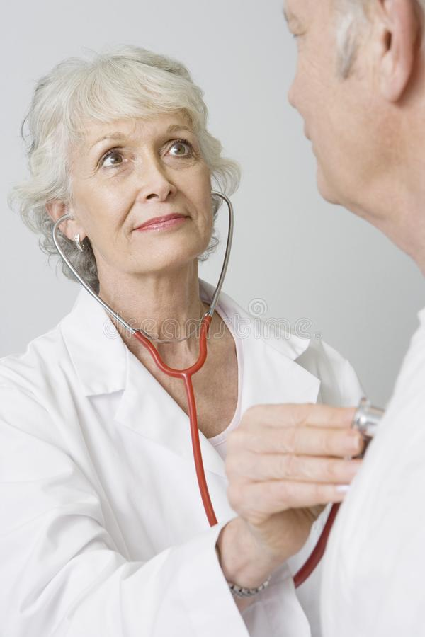 Doctor Checking Patient s Heartbeat Using Stethoscope