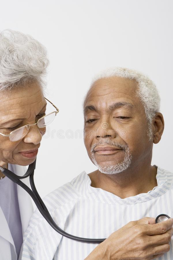 Download Doctor Checking Patient's Heartbeat Using Stethoscope Stock Photo - Image: 29666008