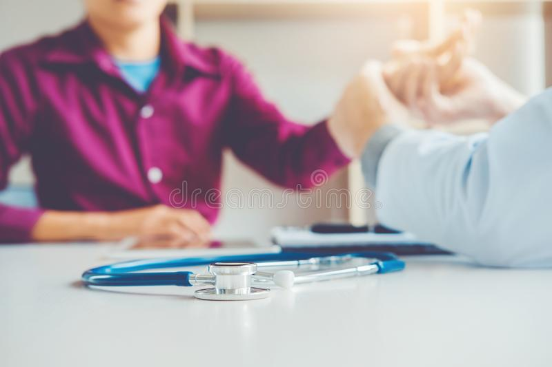 Doctor checking pulse for patients Health care in hospital royalty free stock images