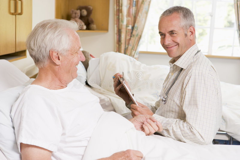 Doctor Checking Up On Senior Man stock image