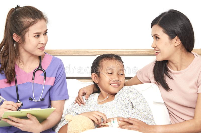 Doctor and child with mother in hospital royalty free stock images