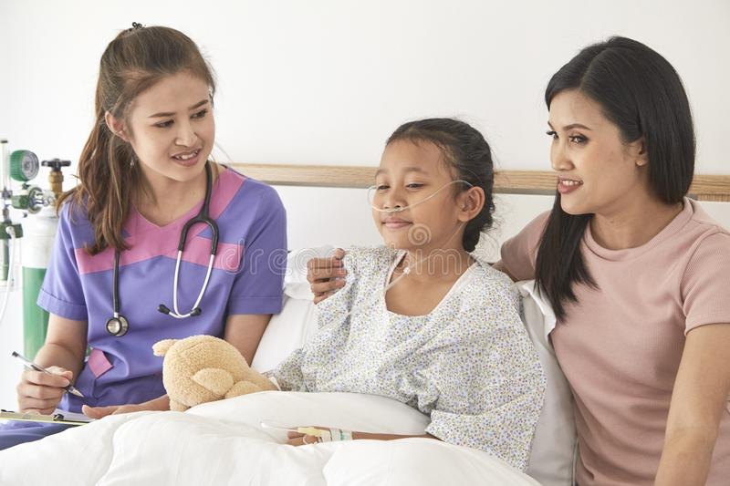 Doctor and child with mother in hospital royalty free stock photo