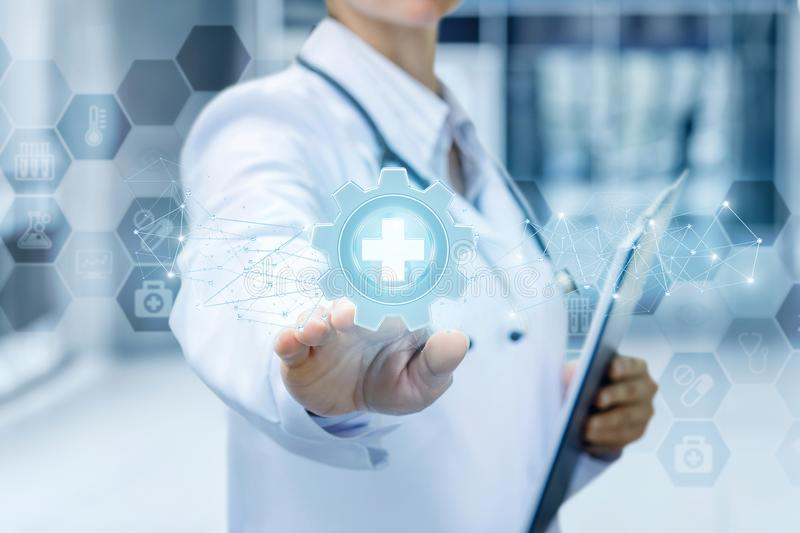 Doctor clicks on medical equipment icon . Doctor clicks on medical equipment icon on a blue background stock photo