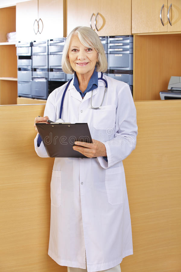 Doctor with clipboard in hospital stock photos