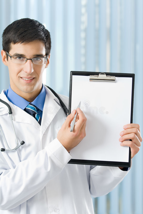 Doctor with clipboard at office stock images