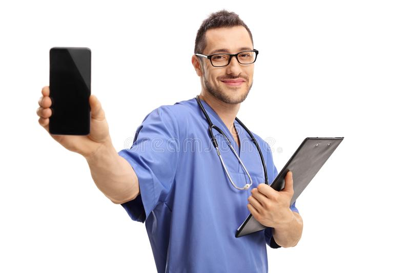 Doctor with a clipboard showing a phone. Isolated on white background stock photo