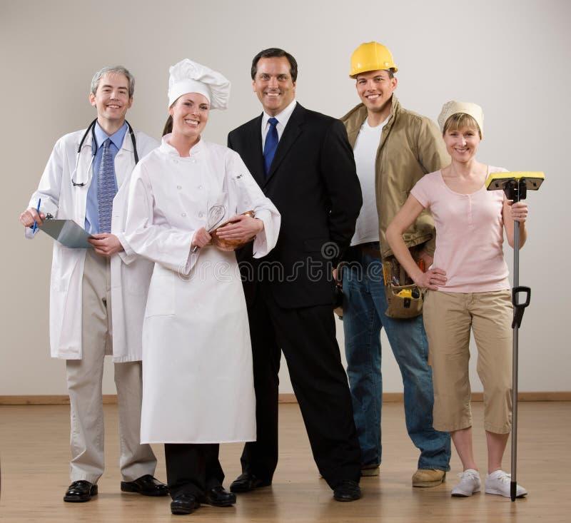 Doctor, cocinero, trabajador de construcción y ama de casa foto de archivo libre de regalías