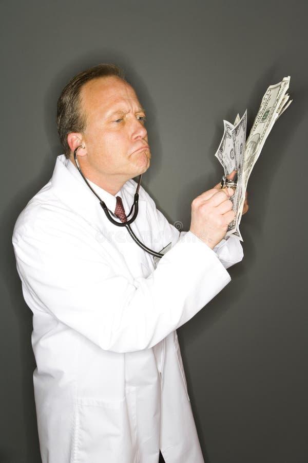 Doctor codicioso fotografía de archivo libre de regalías