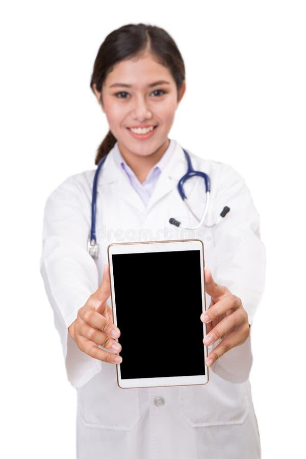 Doctor con PC de la tablilla foto de archivo