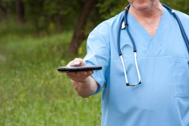 Doctor concept. A man is holding a smart phone royalty free stock photography