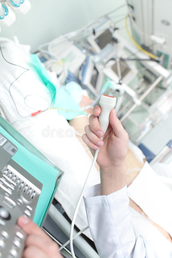 Doctor conducts ultrasound in the ICU. Photo stock images