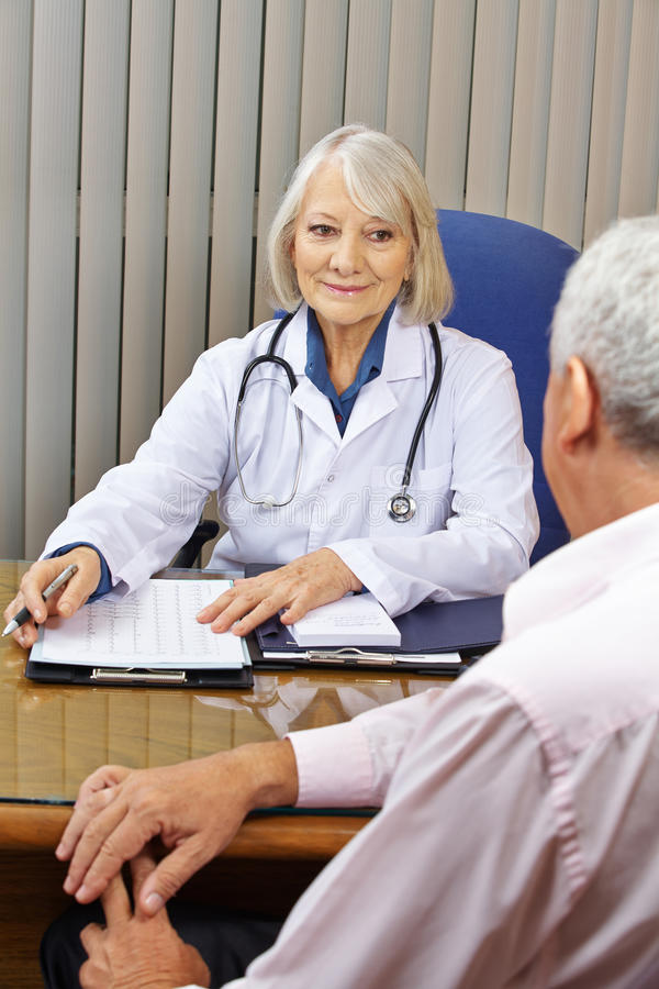 Doctor at consultation in office royalty free stock photo