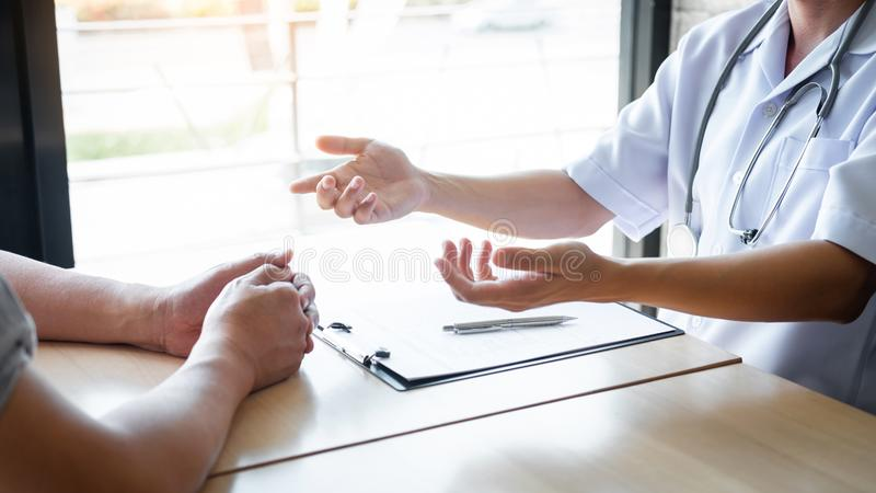 Doctor consulting with patient examining for patient, presenting results symptom about the problem and recommend treatment method royalty free stock photo