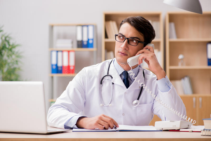 The doctor consulting patient over the phone. Doctor consulting patient over the phone stock image